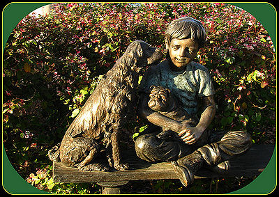 Statue of a boy and his dogs