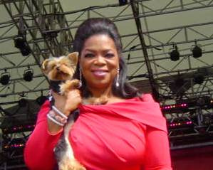 Oprah with a dog in NY
